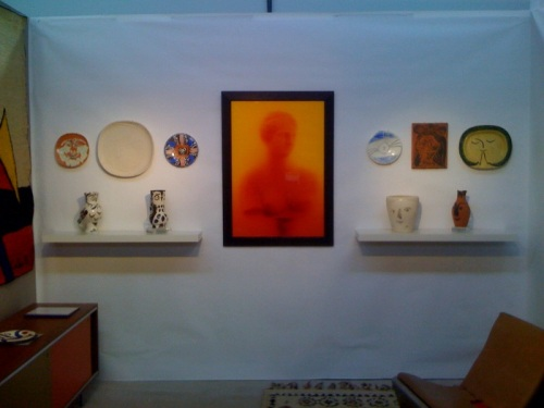 Picasso wall of ceramics and Andres Serrano photograph